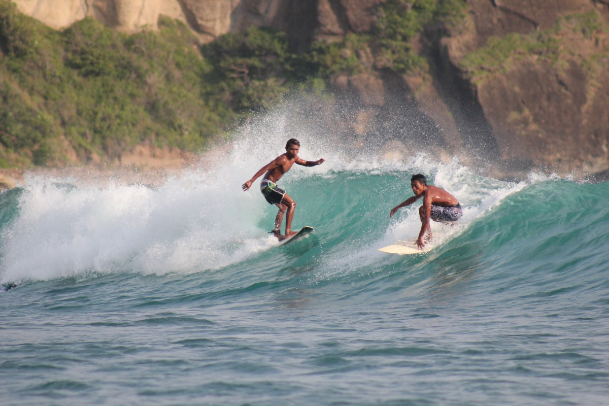 Learn to surf from these 2 Teachers of DHM surf school Kuta Lombok Indonesia